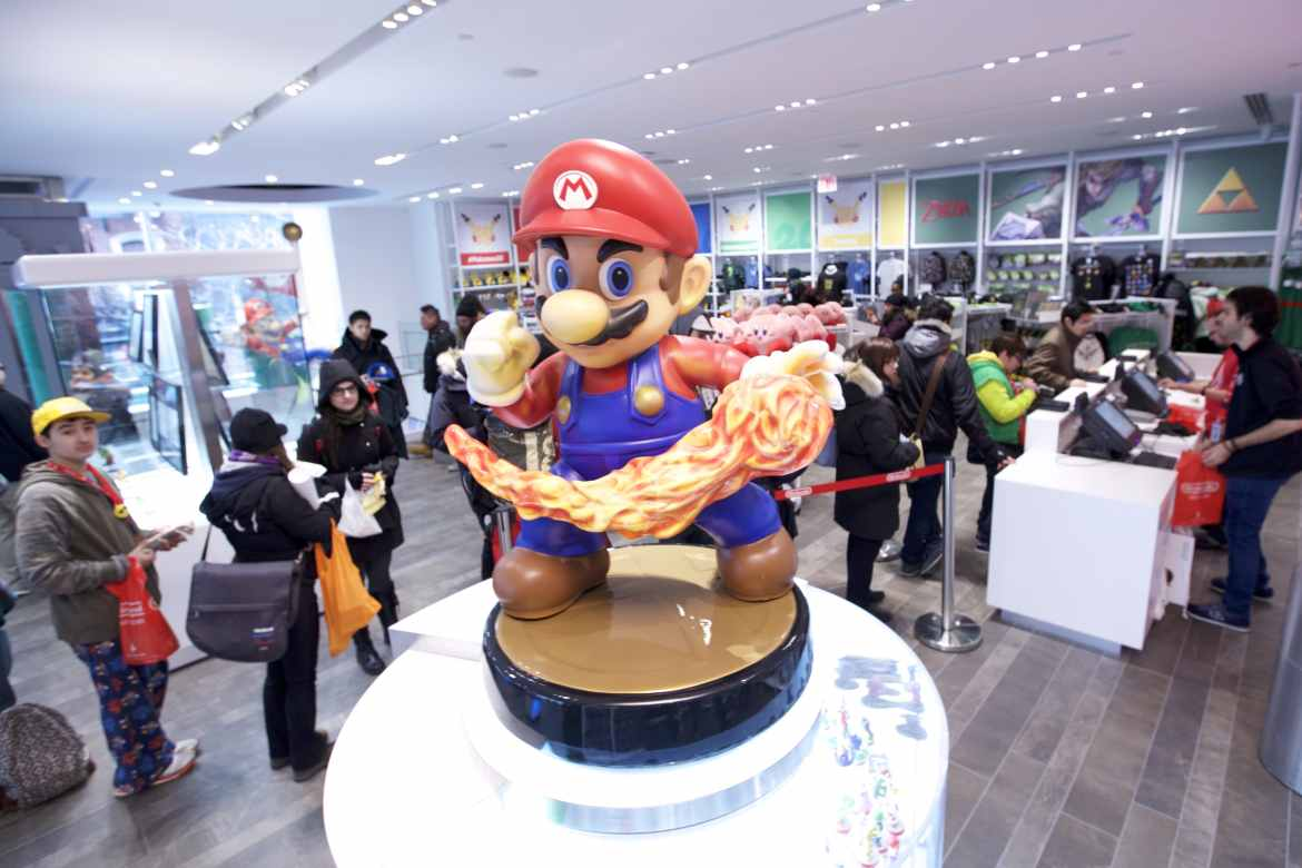 In this photo provided by Nintendo of America, guests explore the remodeled Nintendo NY store at the reopening on 19th February 2016.