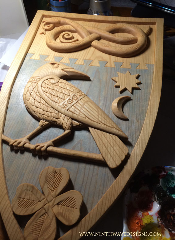 Beginning the painting process for the Marriage Shield.