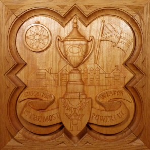 "SPS Form of 1994 Plaque, 11.25"" x 11.25"", stained basswood."
