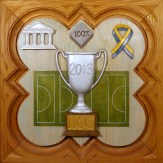 "SPS Form of 2013 Plaque, 11.25"" x 11.25"", painted basswood."