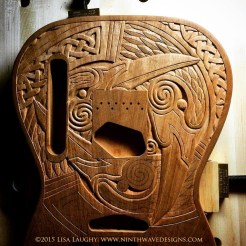 Two of the ravens are carved, working on the third.