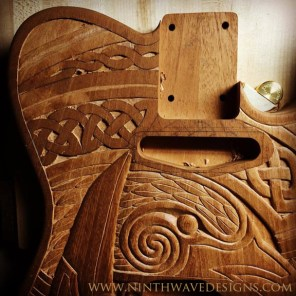 Carving some of the knotwork near the neck.