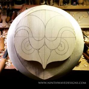 Outside edges of the carving are shaped.