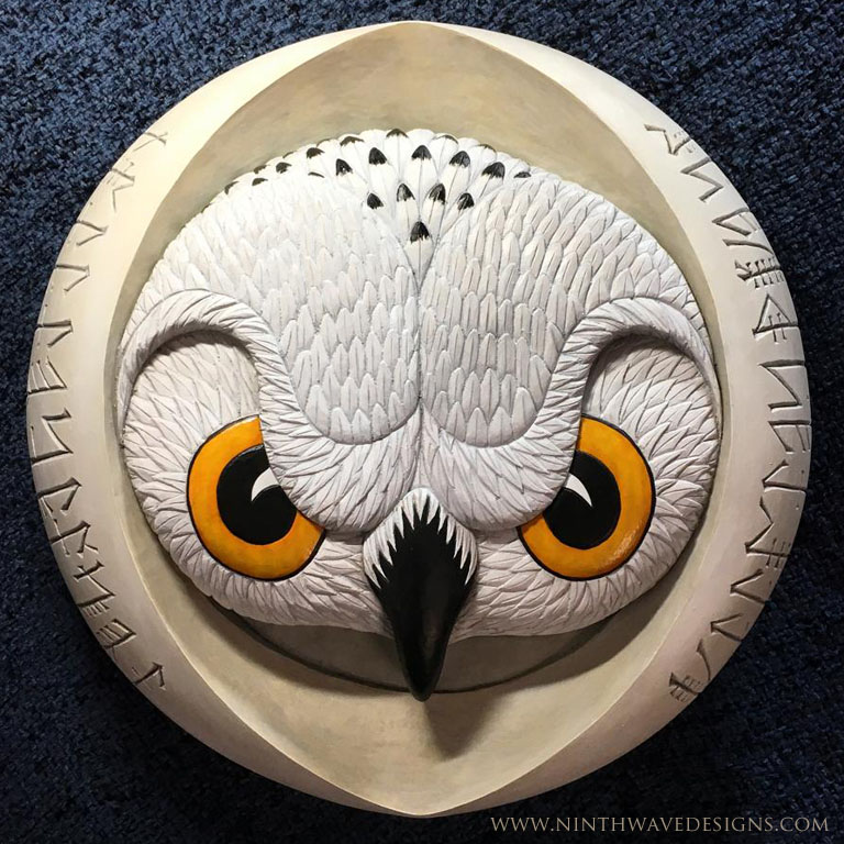 "Old Woman of the Night: Hand carved basswood with painted finish 11.75"" diameter x 2"" thick."