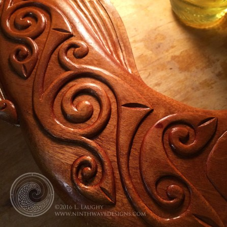Linseed oil glistens on the wood and brings out the rich color of hte mahogany.
