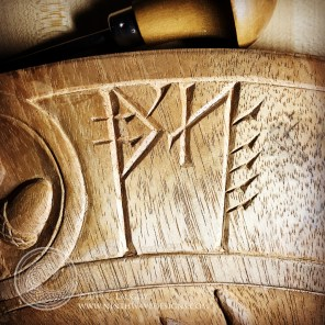 Carving the first of the runes.