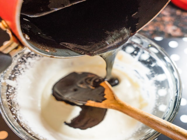 Add the chocolate mixture to the beaten cream