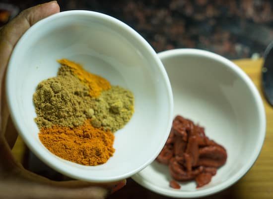 Take 3 tbs of tomato paste, add in chilli powder, coriander powder, turmeric powder, garam masala
