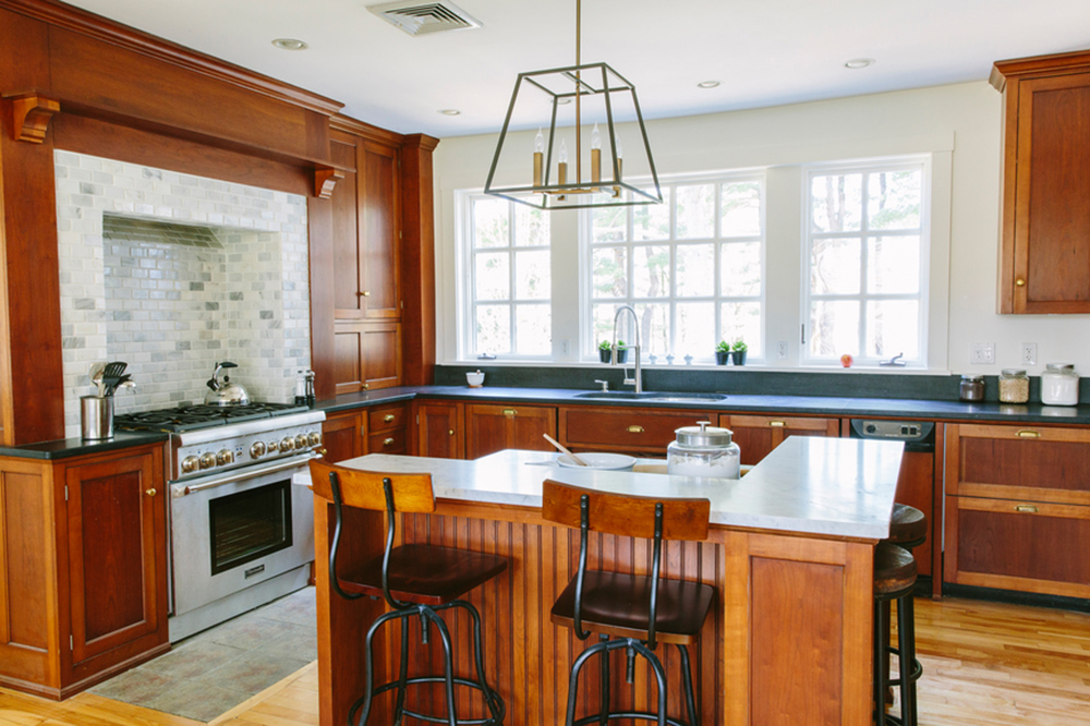 Stained wood cabinets gourmet kitchen