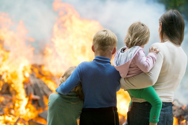 Mother and Children in Front of Home Fire