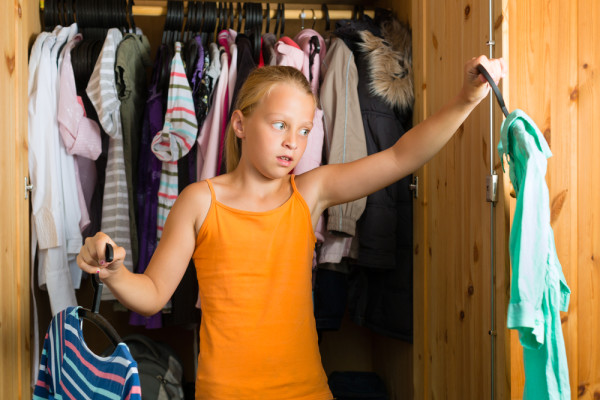 Teen Cleaning Out Closet