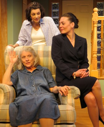 "Dana Benningfield, standing, with Marnie Andrews, left, and Cory Tazmania, in ""The Realization of Emily Linder."""