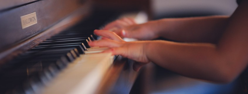 Child learning to play the piano. professional resume writer NJ, resume writer nj, cv, resume, cv resume