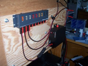 Rigrunner 4008H mounted on rear of desk to replace all 12 V DC wall warts