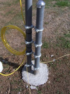 30 Meter MonoGap mounted to vertical post in cement, shows ground radials, and lighting choke