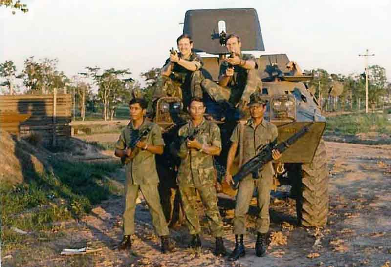 3. NKP RTAFB, V100: Sgt. Green (top left), Sgt. Vasquez (top right), and three four Thai Guards (front). 1973.Photo by: Curtis Hammond, NKP, 56th SPS, QRT Heavy weapons, 1973-1974.