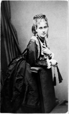Photo by Alexander Bassano (1829-1913) who was one of the most successful English photographers of the 19th century owning various studio's. Between 1859 and 1863 he had a portrait studio at 72 Piccadilly, London West where this carte de visite portrait of Flora MacDonald Rivington was made. Her date of birth in Kolkata, West Bengal, India is unknown, but she died in 1917 in Worthing, West Sussex, England. She was married to the book printer Alexander Rivington (1837-1917) who died one month after she did.Alexander Bassano made world famous portraits of queen Victoria as well as the portrait of a pointing army general Lord Kitchener that was used in 1914 on a notorious poster saying: 'Britons, I want you to join your country's army'. The National Portrait Gallery in London houses the immense archive of the Bassano studio's and has put more than 46.000 of his portraits online. Not this one :). Flora is the second Bassano portrait in our collection.