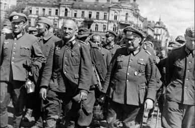 Photo by Georgy Ugrinovich. Soviet Union, August 16, 1944. Guarded by the Soviet army, defeated nazi officers and soldiers are being driven trough the streets of Kiev (now Kyiv, Ukraine). Thanks to Valeriy Miloserdov who regognized the photo as being made by Georgy Ugrinovich.