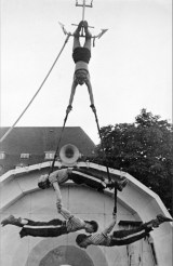 A small photograph made in the mid 20th century by the Danish photographer Carl Emil Karstrøm, probably in the town Aalborg where he lived and worked. On the image: the '4 Kentons', acrobats from the Netherlands. On the back of the picture two addresses: the one of Karstrøm in Aalborg and of the performing artists at the Marnixstraat 224-1 in Amsterdam. A little research learned that the 4 Kentons were three brothers by the name Korenvaar and a lady of whom I could not find a name. She might be the top person on the picture and if so, she must have been someone special. In the 1930s and 40s, the 4 Kentons performed in- and outside the Netherlands, there are even reports of them performing in the Soviet Union in 1937. On the 16th of April 1940 they were on stage in the famous Amsterdam Circus theatre Carré. Among the other artist that day: Johnny & Jones; Nol van Wesel (Johnny) and Max Kannewasser (Jones), immensely popular Jazz performers at the time. A month later the city was occupied by the Nazi's. During the occupation Jewish Johnny and Jones were deported to concentration camps and killed just before liberation. The 4 Kentons reportedly kept on performing during wartime.On on the 28th of July 2007, The Danish newspaper Nordjyske Stiftstidende published an obituary on Carl Emil Karstrøm who had died at the age of 84. He was not only a photographer but also a stunt pilot, builder and inventor. The obituary tells a romantic story of a self made man with 'the courage to express strong viewpoints'.