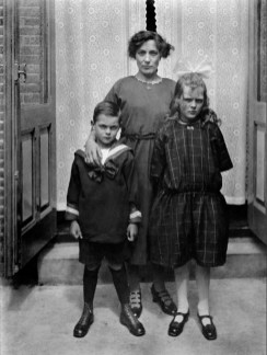 An anonymous photographer made this family portrait of Anna (last name unknown) with her children Stien and Wim. The Netherlands, early 20th century.