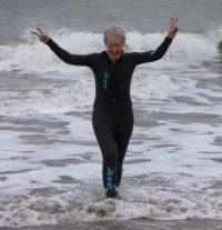 Martha taking a Christmas dip in the Atlantic Ocean off Assateague Island, Virginia.