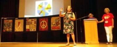 Joyce Fairchild presenting the Tapestry for Peace.