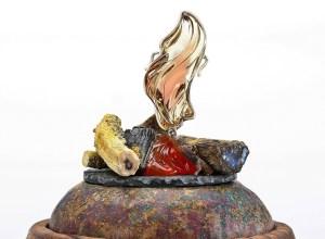'Light My Fire' pendant on its base