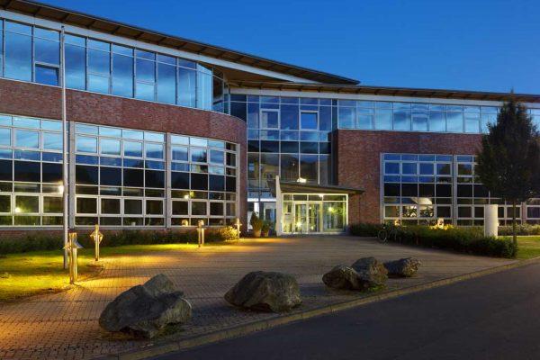 modern-office-building-with-night-blue-sky-PSNDMPR