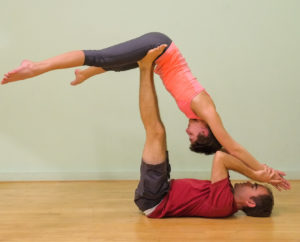 a couple doing yoga