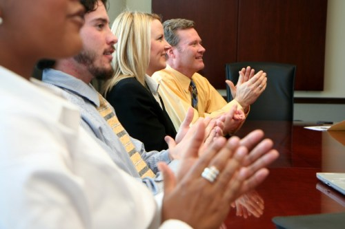 Photograph of an audience clapping | NLP World.