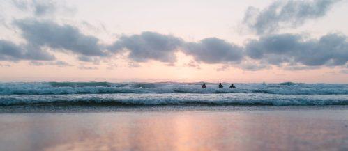 Calm sea, breakers, sunset
