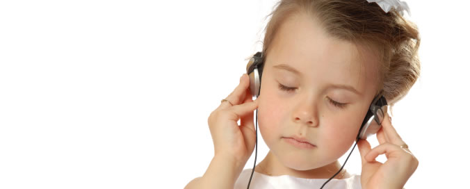 Girl listening to NLP tracks | NLP World