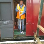 Volunteer Co-ordinator Grahame Every does as Santa has asked and mops the floor of the Grotto