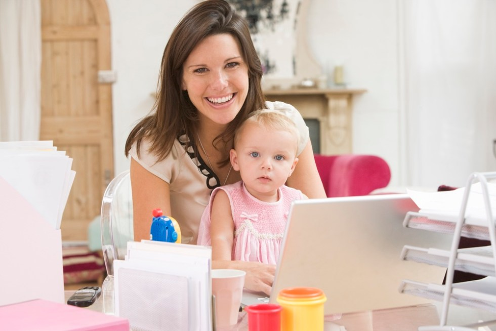 Busy mom working from home with baby