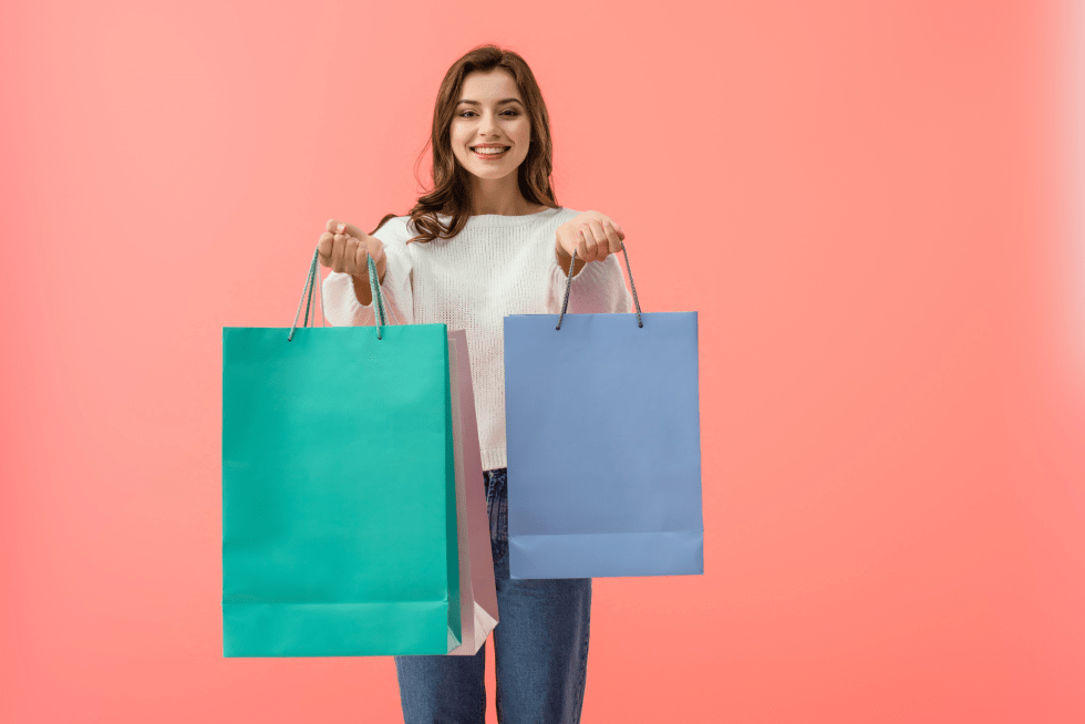 Happy woman with shopping bags. Value concept.
