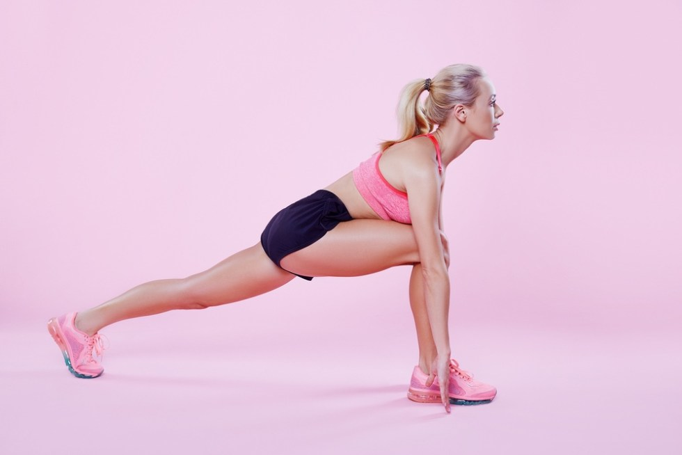 Woman working out. Stretch routine.