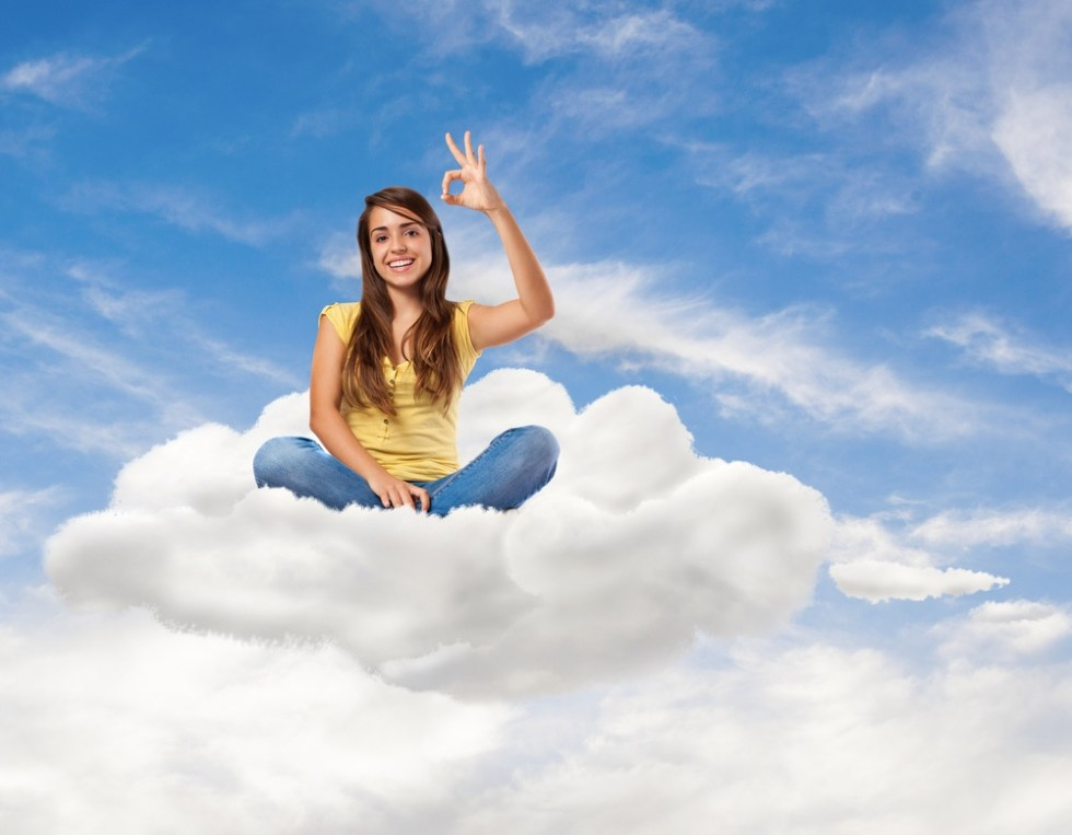 Woman sitting floating on a cloud