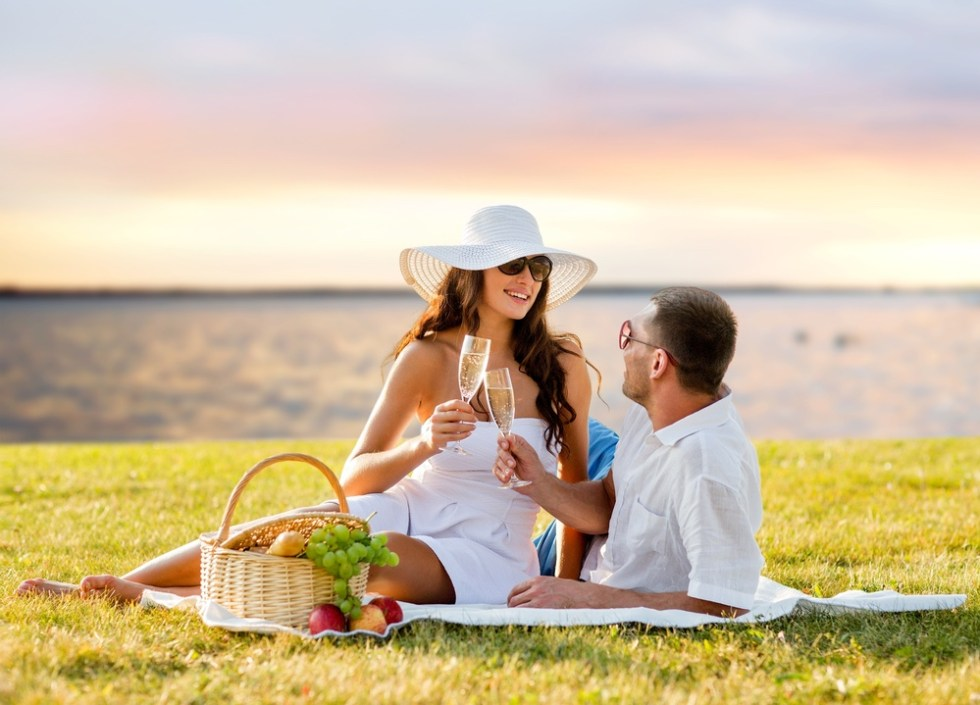 Couple enjoying a Valentines picnic on the beach