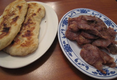 Sesame Shaobing (left) and homemade Szechwan Sausage