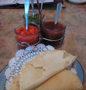 Preprandial pleasure: tamarind, onion and mint chutneys.