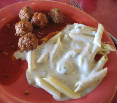 Meatballs and penne pasta with green chile Alfredo sauce