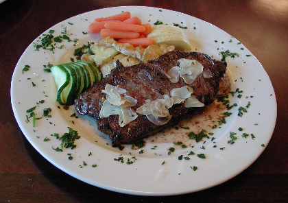 The New York steak with scallopped potatoes.