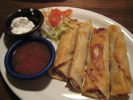 Taquitos with salsa and sour cream