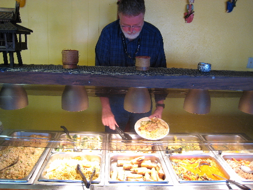 Bill Resnik fills his plate for the fourth time on Tawan's buffet