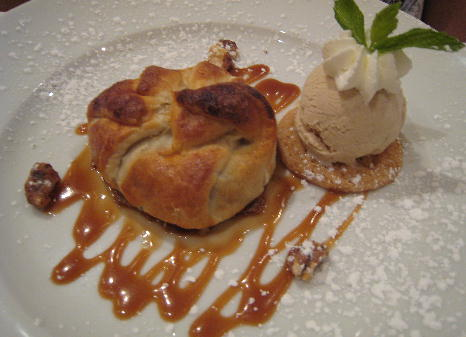 Rustic apple tart with caramel sauce, candied walnuts and cinammon ice cream