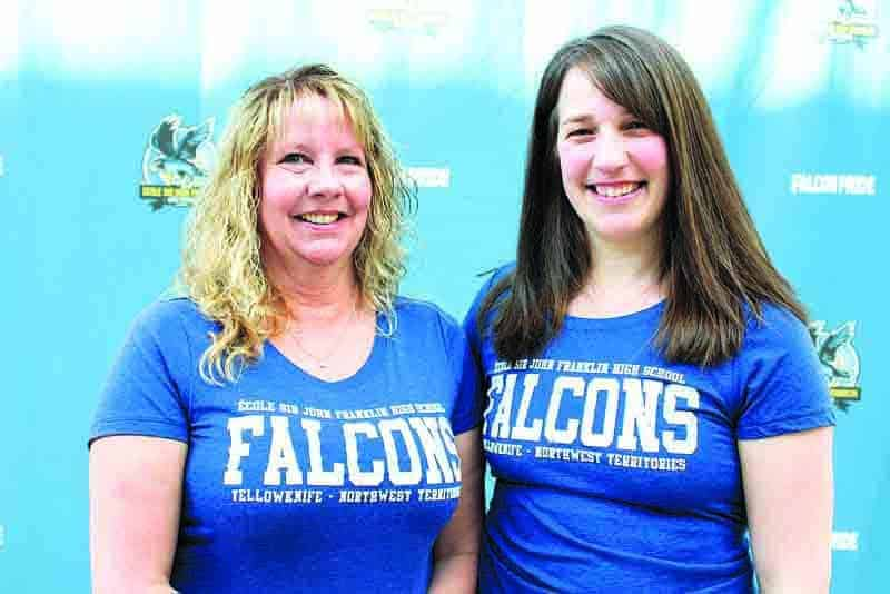 Wendy Malkin, left, and Andrea Pellerin say students at Sir John Franklin High School are what keep them coming back to work each morning as administrative assistants. - Kirsten Fenn/NNSL photo