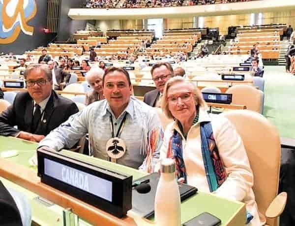 Minister Carolyn Bennett made a public retraction at the UN Headquarters on April 24 of Canadian objection to implementing articles of the UN Declaration on the Rights of Indigenous Peoples that speak to indigenous rights of free, prior, and informed consent. She is pictures here with Grand Chief Ed John, left and National Chief Perry Bellegarde. - photo courtesy of INAC
