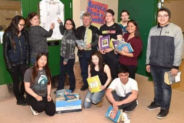 Students and teachers from Inuksuk High School in Iqaluit, seen here with Iqaluit Mayor Madeleine Redfern and Northwestel general manager for Nunavut Bertrand Poisson May 17, collected 515 directories for recycling as part of Northwestel's annual directory recycling program in Nunavut. photo courtesy Michel Albert