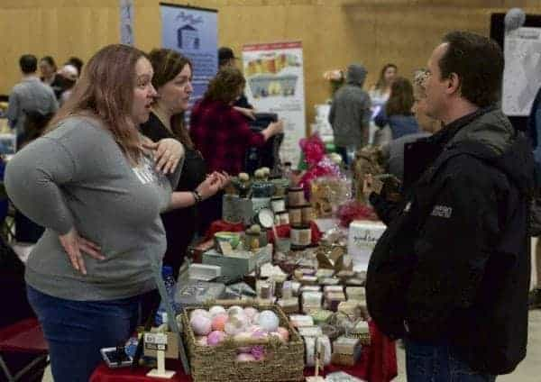Tiffany Thiem-Pennell, left, chats with Al Matesic at Good Times Soap Company booth at the Yellowknife Chamber of Commerce's Spring Trade show on the weekend of May 13. In the back left, business owner Karen Wood also chats with a visitor. Robin Grant/NNSL photo