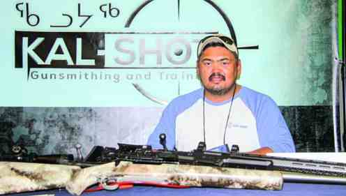 Joeffrey Kaludjak promotes his passion and part-time business (KAL-SHOT) of gunsmithing and training at the Kivalliq Trade Show in Rankin Inlet on Sept. 25, 2018. Darrell Greer/NNSL photo